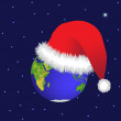 Globe and Christmas hat — Stock Photo