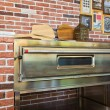 Pizza oven in cafe — Stock Photo