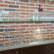 Glass shelves with stemware — Stock Photo