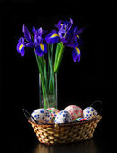 Easter eggs with bouquet of iris — Stock Photo