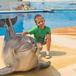 Boy and dolphin — Stock Photo