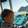 Boy at the helm of a ship — Stock Photo