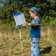 Boy draws a picture — Stock Photo #31217039
