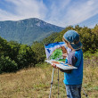Boy draws a picture — Stock Photo