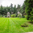 Lawn and arbor in park — Stock Photo #36034177