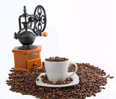 Old handmill with coffee bean — Stock Photo