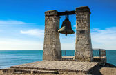 Ancient bell against sea — Stock fotografie