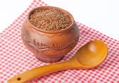 Seeds of flax in ceramic pot — Stok fotoğraf