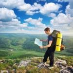 Man tourist in mountain — Stock Photo #12077429