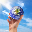 Stock Photo: Earth in hand