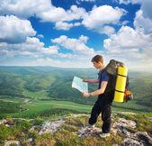 Man tourist in mountain — Stock Photo