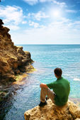 Man in sea cave — Stock Photo