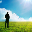 Man in green meadow — Stock Photo