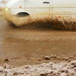 Car splash the puddle — Stock Photo #38598131