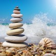 Stone pyramid on a seashore — Stock Photo