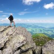Man on peak of mountain. — Stock Photo