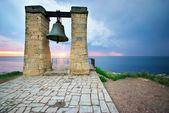 Big bell on sea shore — Stock Photo