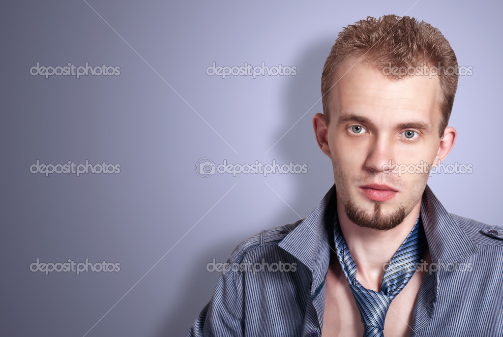 Portrait handsome fashion man in shirt and tie. Studio fashion shoot — Stock Photo #12180899