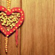 Royalty-Free Stock Photo: Red heart on the wood background