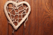 Rope heart on wood background — Stock Photo