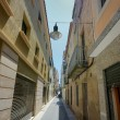 Stock Photo: Old street with rusty walls Spain