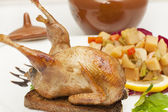 Roasted quail entirely on croutons — Stock Photo