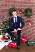 Young guy next to a Christmas tree — Stock Photo