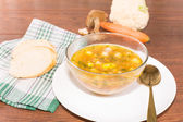 Glass bowl of soup — Stock Photo