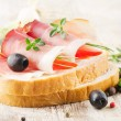 Sandwich on a wooden table - Stock Photo