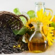 Sunflower oil and sunflower seeds — Stock Photo