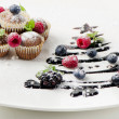 Royalty-Free Stock Photo: Cupcakes with fresh berries  and sweet  christmas tree