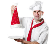 Chef showing empty plate isolated on white — Stock Photo