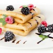 Crepes with blackberries and raspberries — Stock Photo