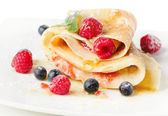 Crepes with berries and mint — Stock Photo