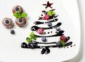 Cupcakes and sweet christmas tree — Stock Photo