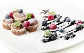 Cupcakes and chocolate christmas tree — Stock Photo