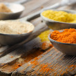 Assortment of powder spices on spoons — Stock Photo #13935589