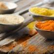 Assortment of powder spices on spoons — Stok fotoğraf