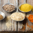 Assortment of powder spices on spoons — Stock Photo #13935601