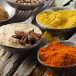 Assortment of powder spices on spoons - Stock Photo