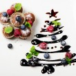 Stock Photo: Cupcakes and sweet christmas tree with berries