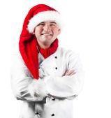 Smiling chef in Santa hat — Stock Photo
