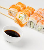 Sushi on chopstick — Stock Photo