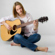 Woman playing acoustic guitar — Stock Photo #15525171
