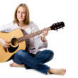 Young attractive woman playing acoustic guitar — Stock Photo #15525619