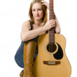 Young beautiful woman with guitar — Stock Photo
