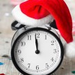 Alarm clock with Santa hat — Stock Photo