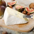 Cheese  on wooden platter — Stock Photo