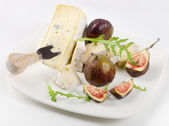 Cheese on white plate — Stock Photo
