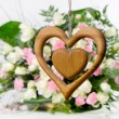 Wooden heart on flower background — Foto Stock